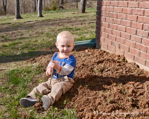 My son loves to help, especially when the task includes dirt and digging.
