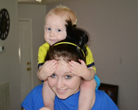 My little man usually sits on my sister's shoulders during the warm up each morning. How cute are these faces??