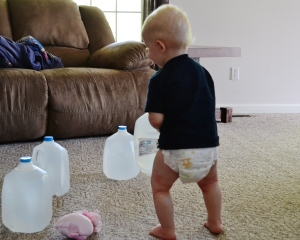My little man loves to help me exercise, and a whole gallon of water makes a super weight, but he's game. (I forgot to purchase dumbbells, so gallons of water are my weights right now.)